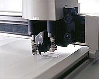 Flat bed cutting plotter